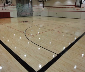 A picture of a hardwood gym floor system