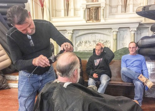 Michael Rondinelli of Empire Education Group volunteered to provide haircuts for the group.