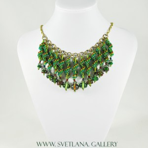 Christmas Necklace featuring handmade glass beads and bead-woven components made by Svetlana