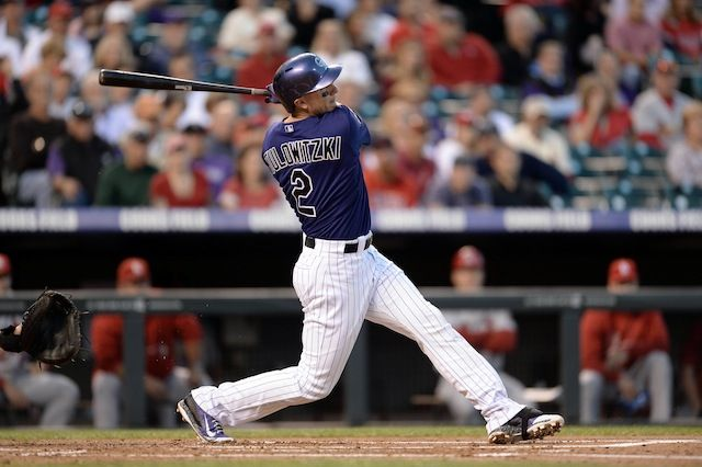 Sept 16, 2013; Denver, CO, USA; Colorado Rockies shortstop Troy Tulowitzki (2) hits a double in the first inning of the game against the St. Louis Cardinals at Coors Field. Mandatory Credit: Ron Chenoy-USA TODAY Sports