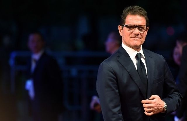 Russian national football team manager Fabio Capello poses on the red carpet as he arrives ahead of the Laureus World Sports Award ceremony at the Grand Theater in Shanghai on April 15, 2015.  The holding of the awards ceremony in the commercial hub of Shanghai comes as Beijing bids for the 2022 Winter Olympics, amid rumours that China could even seek to host the 2026 football World Cup.       AFP PHOTO / JOHANNES EISELE