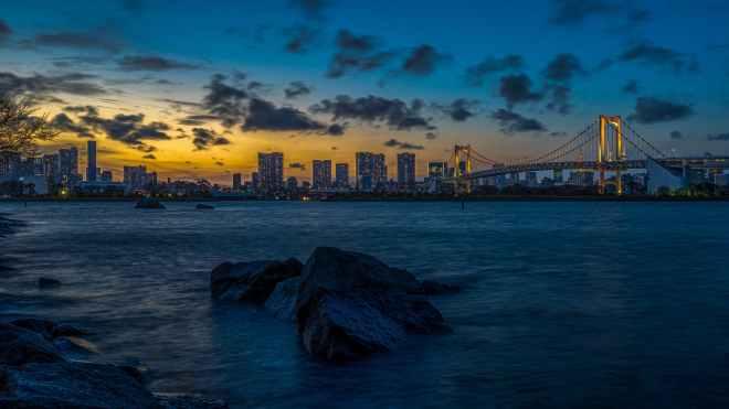 skyline photography of buildings and bridge