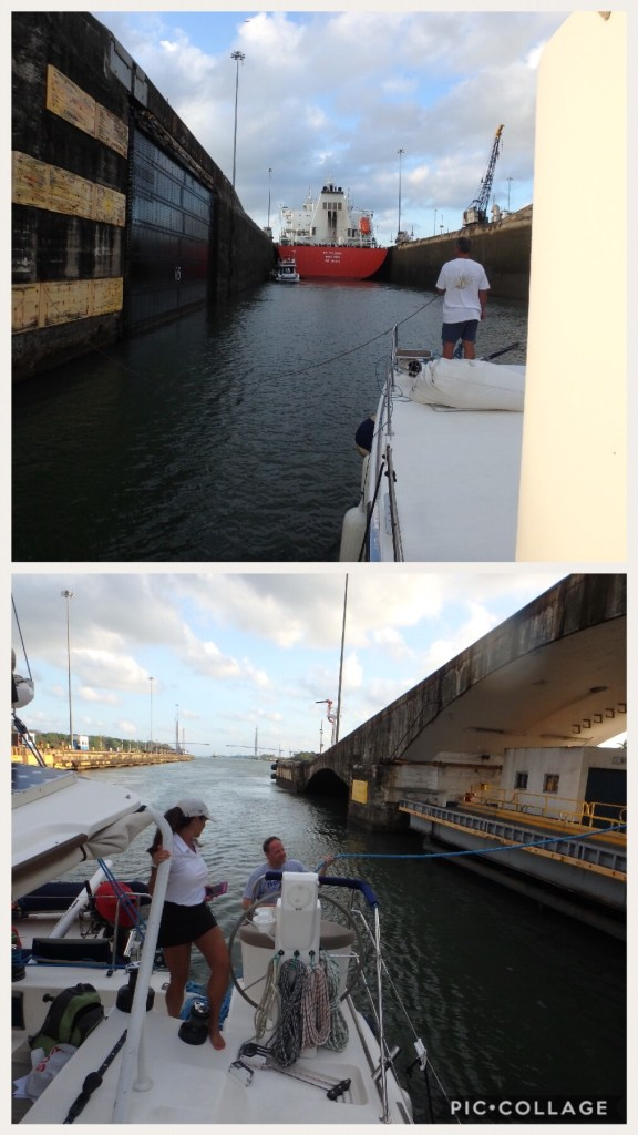 Panama line handlers walking our nested boats to center chamber.