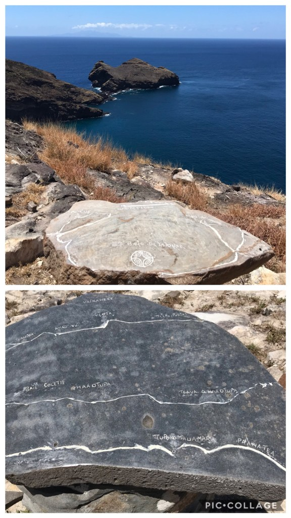Maps carved in stone at top of hill