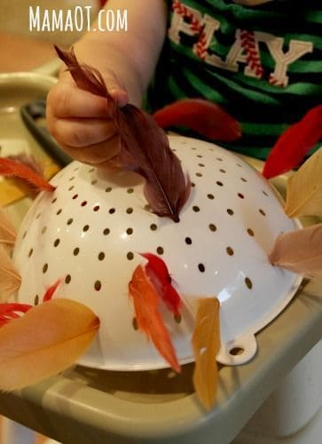 A fine motor skill Thanksgiving activity. Feathers and a colander! More Thanksgiving activities in blog post!