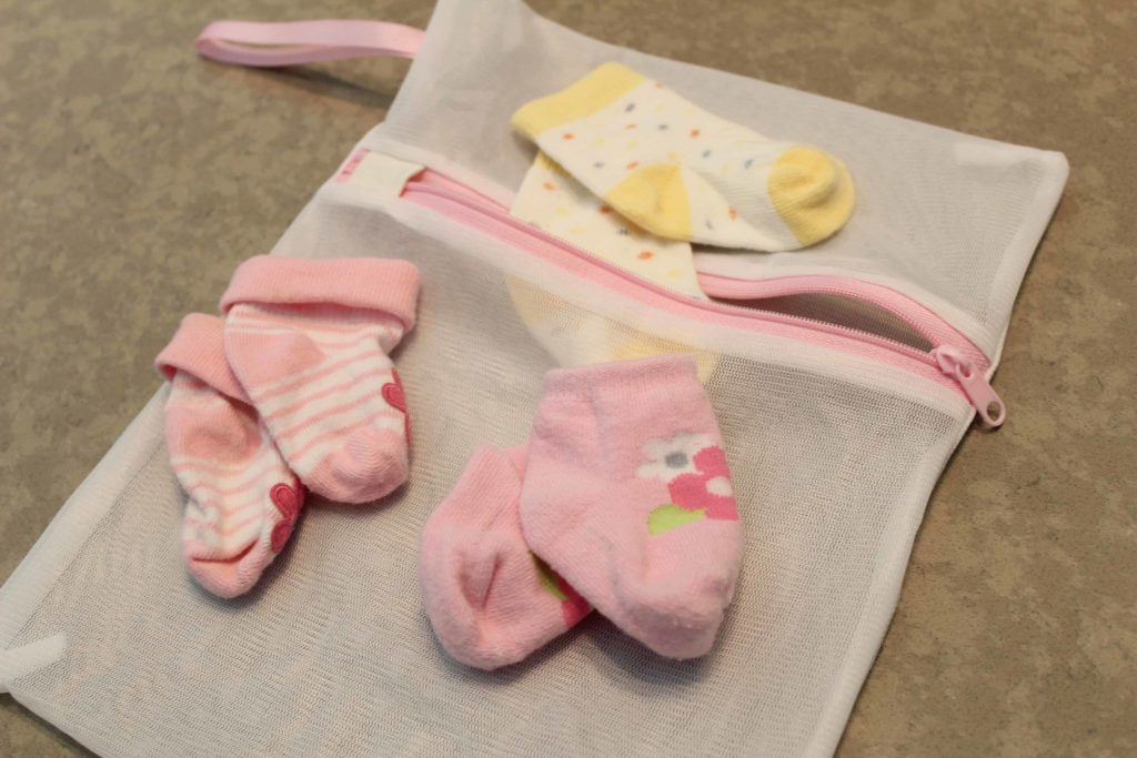 Wash baby socks in a mesh bag to make matching easier and to avoid losing any in the wash