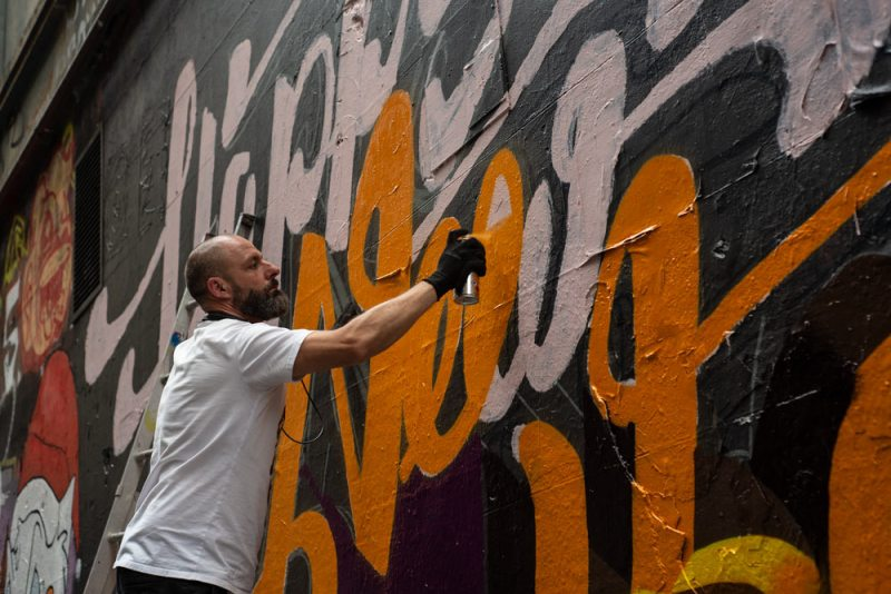 Spray painting a wall