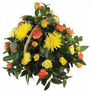 Yellow and orange floral arrangement - Swanborough Funerals