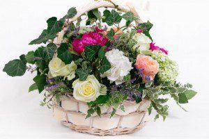 floral arrangement in a basket - Swanborough Funerals