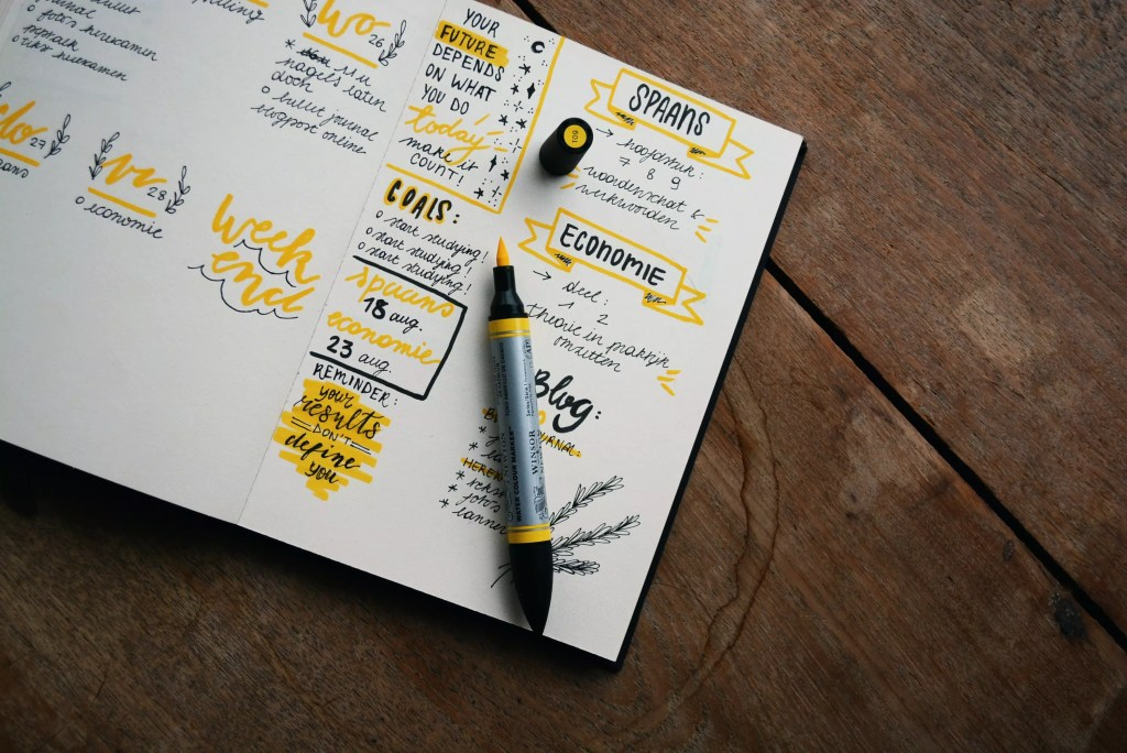 bullet journal with highlighter and marker writing