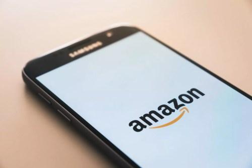 smartphone displaying Amazon logo from a Peloton Amazon Bike blog post