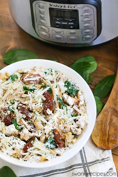 Instant Pot Tuscan Chicken Pasta - A 5 minute one pot pressure cooker recipe. This Italian pasta is made a creamy parmesan cream cheese sauce, and chicken breasts. The BEST Instant Pot pasta recipe to try!