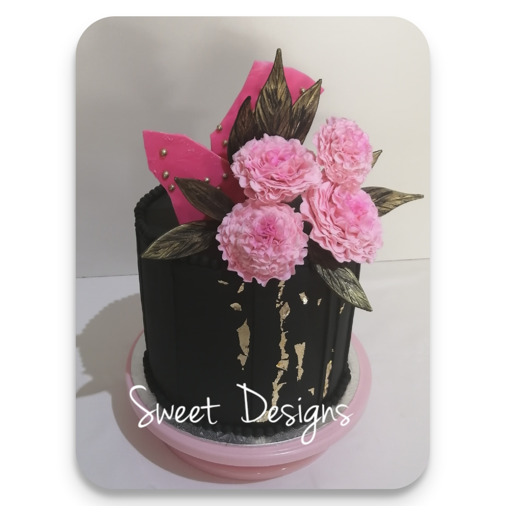 Black and Pink Birthday Cake with pink Gumpaste Carnations