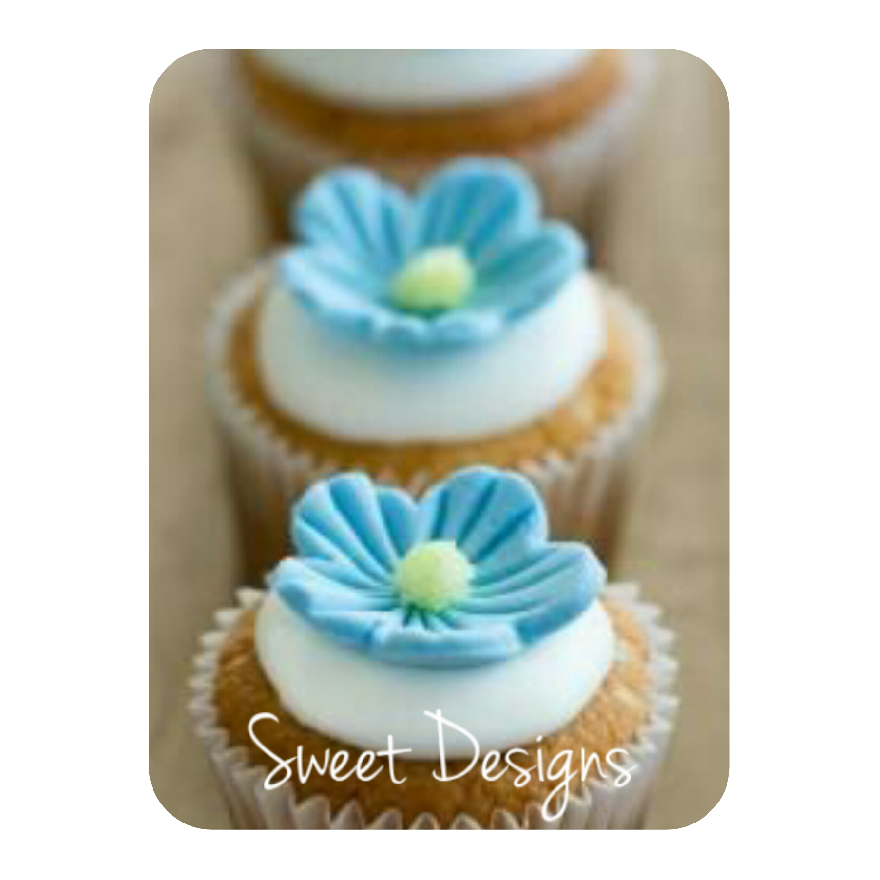 Vanilla Cupcakes with little blue fondant flower
