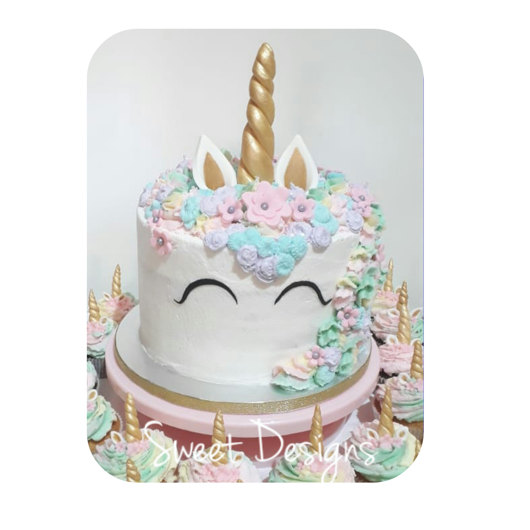 Unicorn Birthday Cake with cupcakes