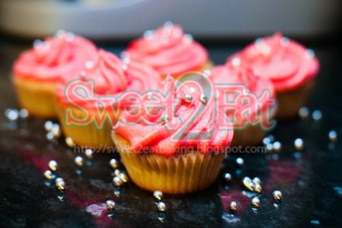 Vanilla cupcakes with vanilla pink swirls