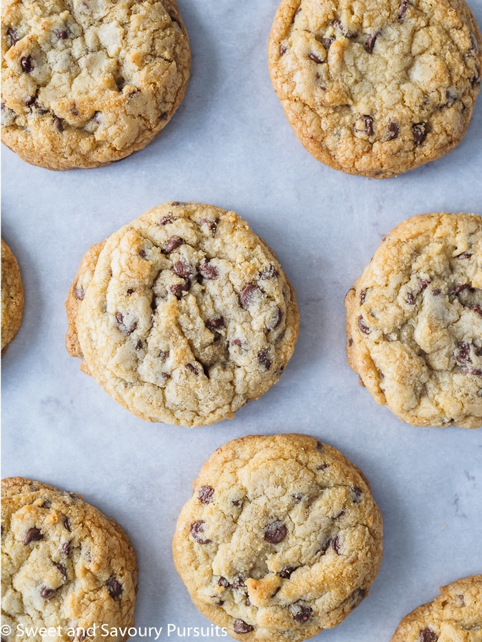 Freshly baked Chewy Chocolate Chip Cookies on baking sheet