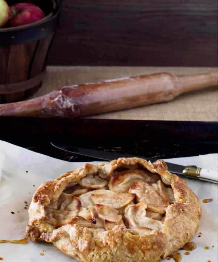 Spiced Apple Galette on baking sheet with knife