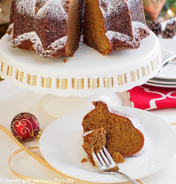 Slice of Espresso Gingerbread Bundt Cake on dish.