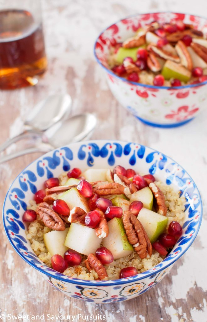 Pear, Pommegranate and Pecan Quinoa Breakfast Bowl served with maple syrup.
