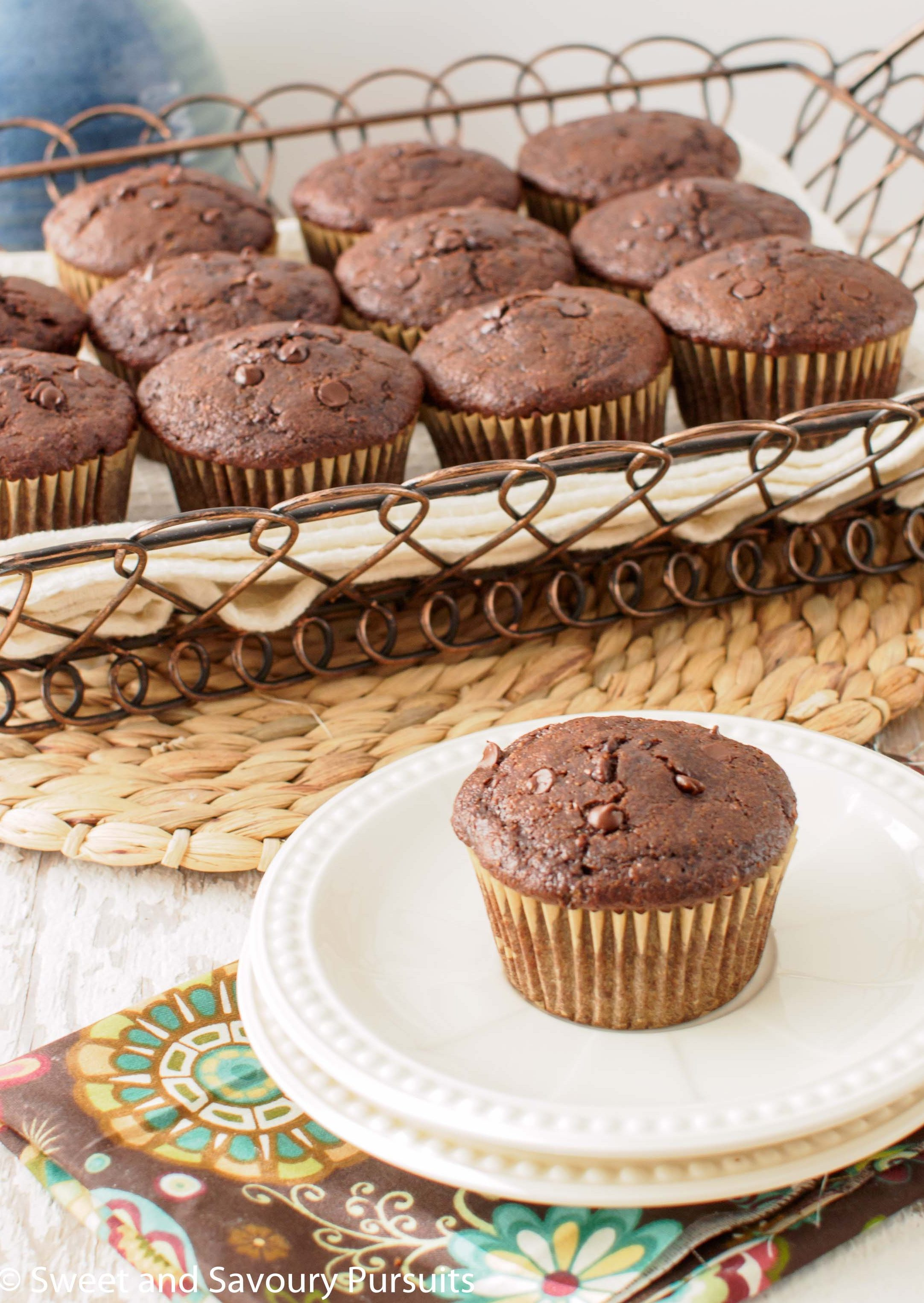 Moist, tender and chocolatey, these Whole Wheat Double Chocolate Zucchini Chai Muffins are a delicious way to start your day.