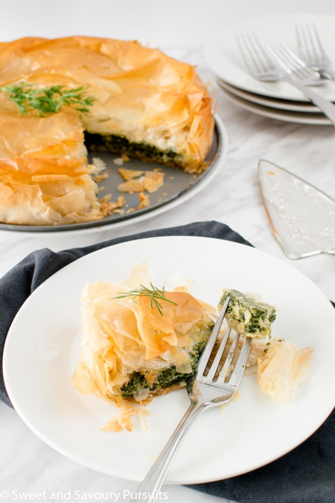 Close-up of a slice of an Easy Spanakopita pie.