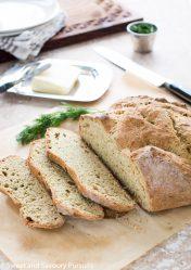 Sliced Irish Soda Bread with Dill on board.