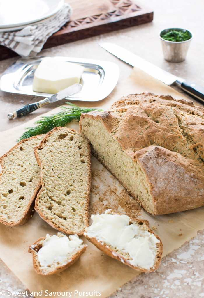 Sliced Irish Soda Bread with Dill with butter on one slice.