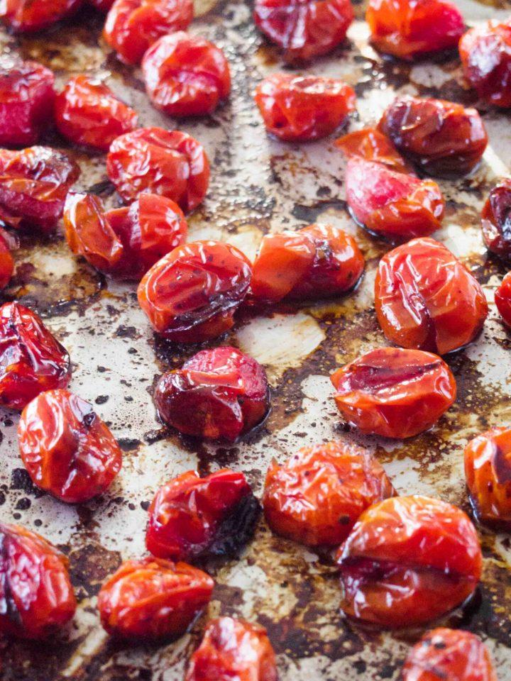 Roasted caramelized tomatoes on baking tray.