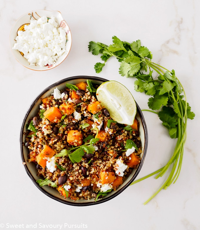 Bowl of quinoa with sweet potato and black beans.