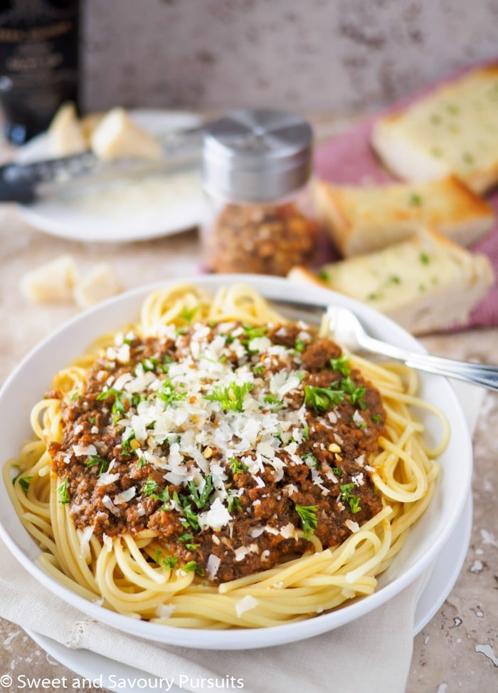 Bowl of spaghetti topped with meat sauce.