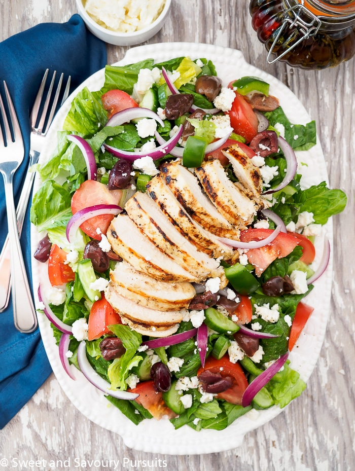 Greek Salad with Grilled Chicken on large dish.