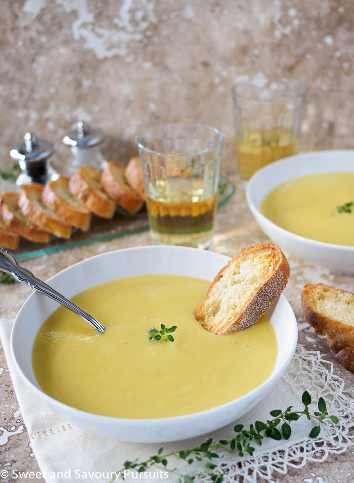 This healthy Creamy Leek and Potato Soup with Garlic Parmesan Crostini is the ultimate fall comfort food.