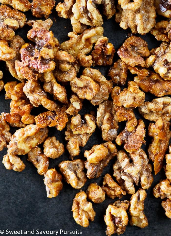 Maple Spiced Walnuts on dark surface
