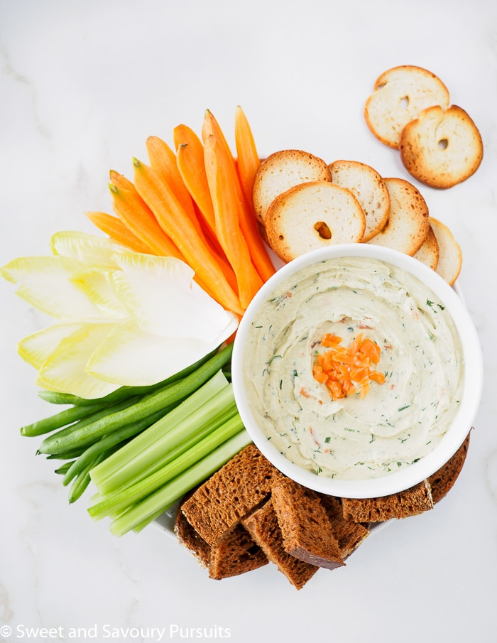 Smoked Salmon Cream Cheese Dip served with carrots, endive spears, celery, bagel crackers and pumpernickel bread.