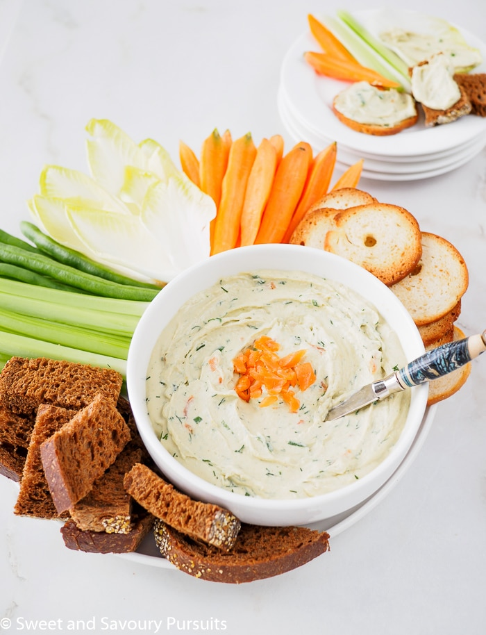 Smoked Salmon Dip served with carrots, endive spears, celery, bagel crackers and pumpernickel bread.