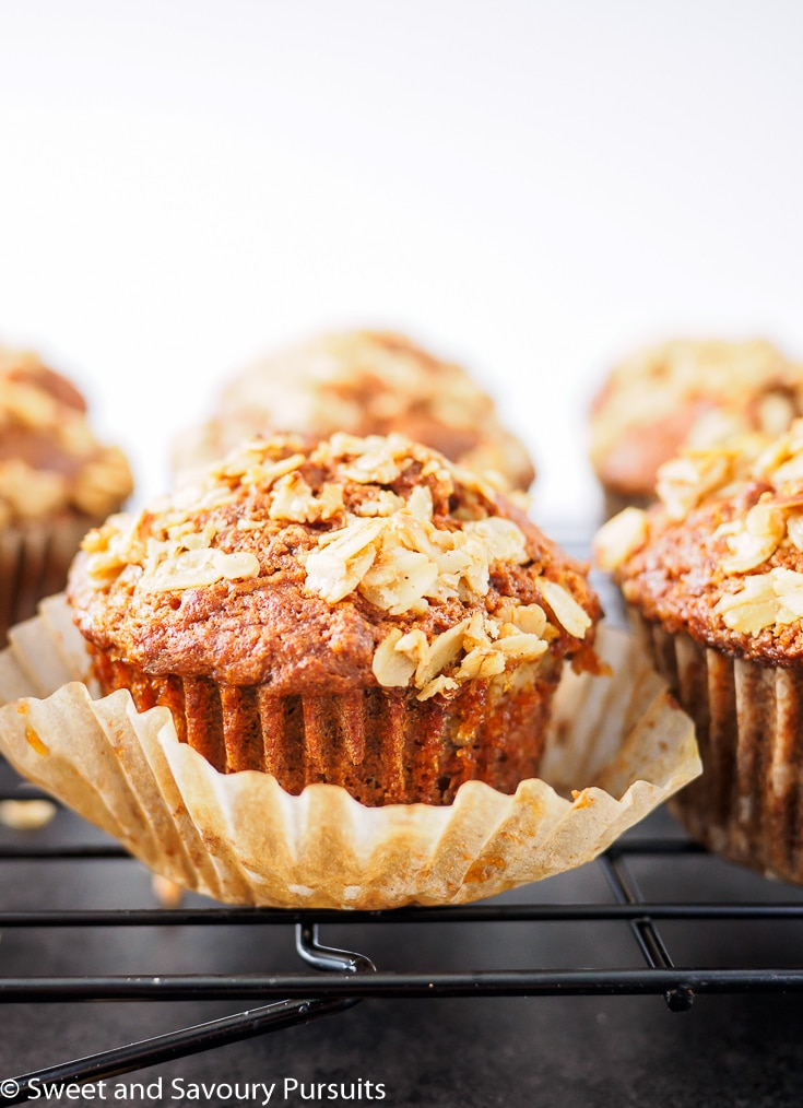 Freshly baked Whole Wheat Carrot Muffins on cooling rack.