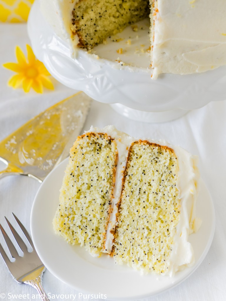 Slice of layered Lemon Poppy Seed Cake with Cream Cheese Frosting