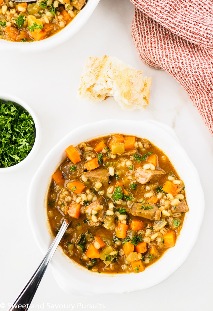 Bowls of Beef Barley Soup with crusty bread