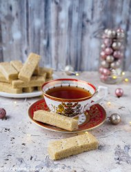 Espresso Cardamom Shortbread Cookies served with a cup of tea.