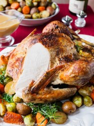 Roast turkey with slice cut off to expose cooked breast.