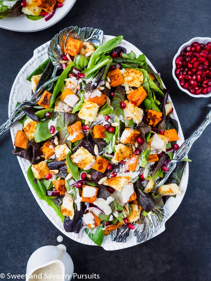 Plate of Roasted Sweet Potato Salad drizzled with Citrus Tahini Dressing