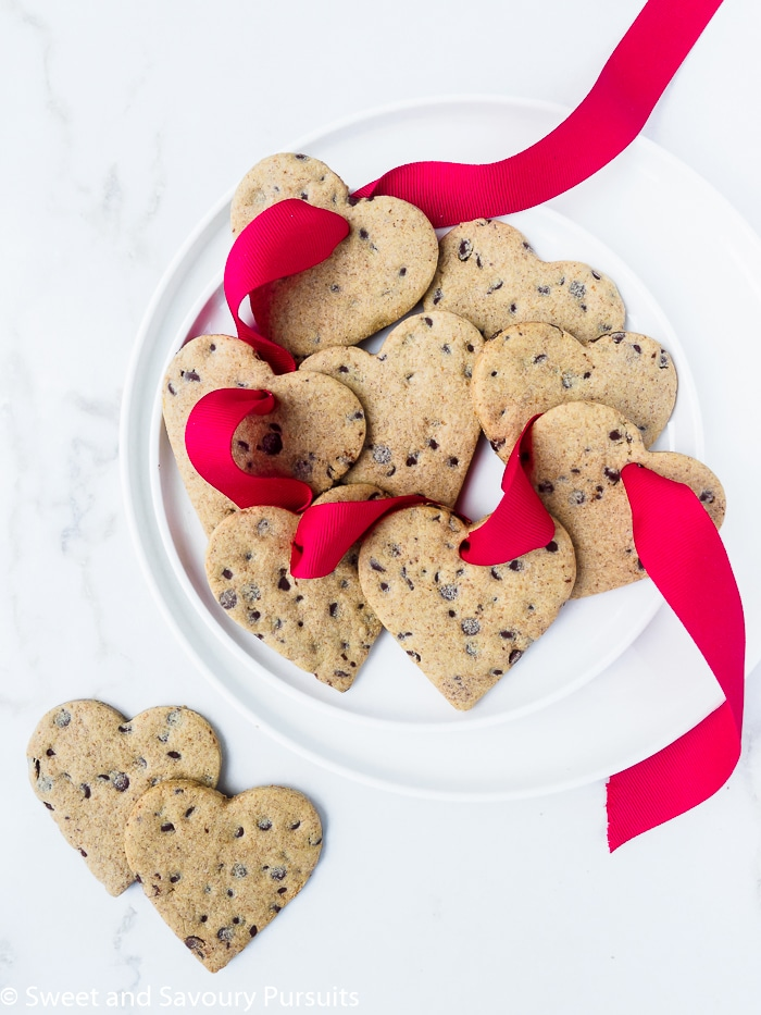 Dish of healthier heart-shaped chocolate chip sugar cookies.