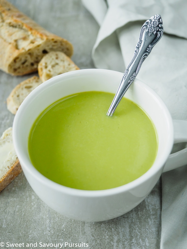 One large white mug with Creamy Asparagus Soup.