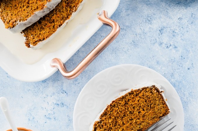 Healthy Carrot Bread served on platter with a slice on a white dish.