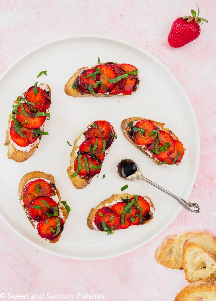 Strawberry Goat Cheese Crostini drizzled with a balsamic reduction.