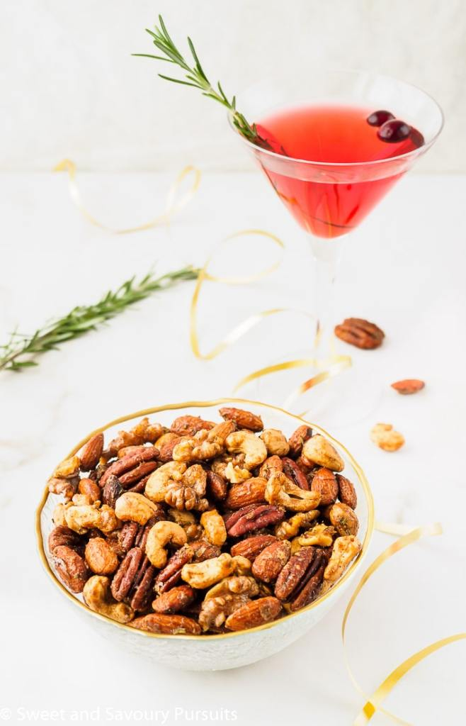 Bowl of Mixed Spiced Nuts served with a cocktail.