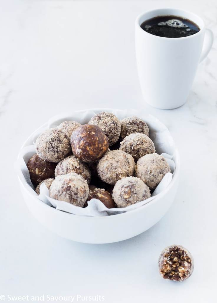 Bowl of already made No-Bake Maple Espresso Bites served with a cup of coffee.