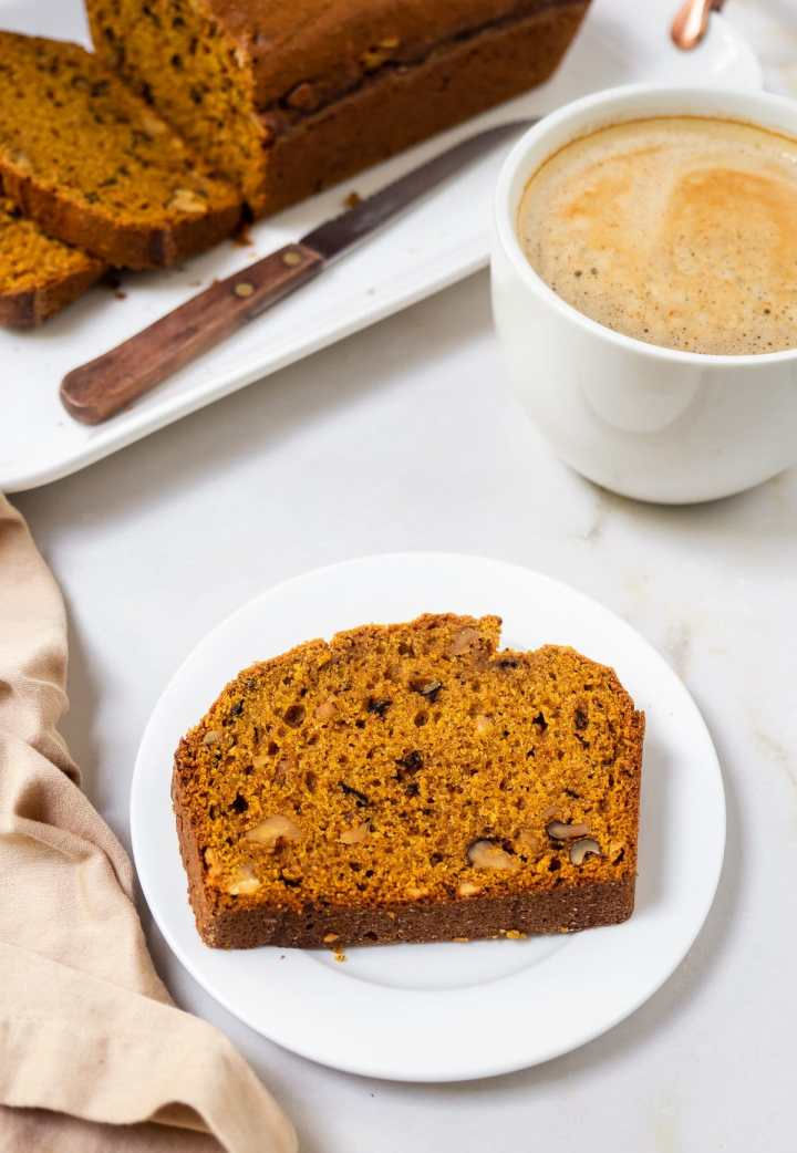 Plated slice of a Pumpkin Walnut Loaf