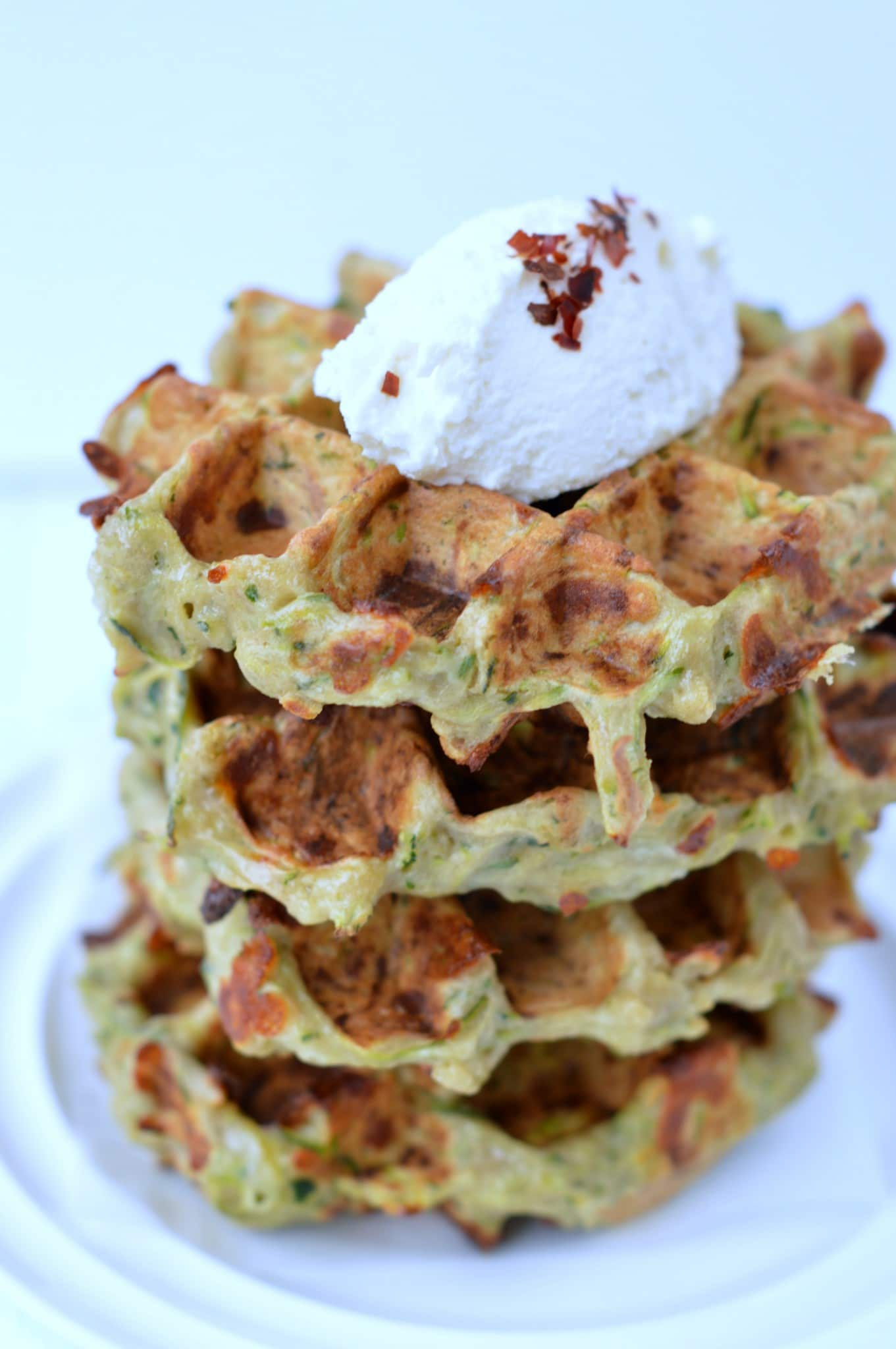 Gluten free Zucchini Waffles stuffed with grated zucchini and parmesan. An easy clean eating recipe for dinner or a tasty savory breakfast that all the family love